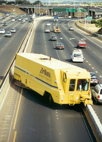 HDOT's yellow Zipmobile, turning the eastbound zipper lane back into two westbound regular lanes