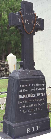 Grave marker for St. Damien's tomb: V.C.J.S. | Sacred to the Memory | of the Revd. Father | Damien Deveuster | Died a Martyr to the Charity | to the afflicted Lepers | April 15, 1889 | R.I.P.