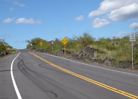 West end of state route 160; road continues beyond 'End State Highway' sign, turning into paved but much narrower one-lane county road