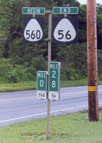Begin sign for route 560 with zero milepost, alongside end sign for route 56 with terminal milepost underneath