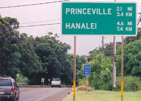 Sign on route 56, indicating distances to Princeville and Hanalei, in both miles and kilometers