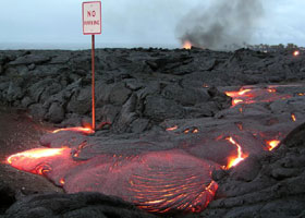 'No parking' sign with lava flowing around the signpost onto the pavement beneath