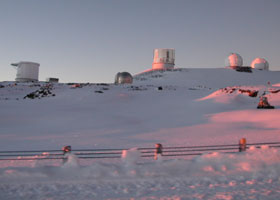 Five telescopes atop the snow-covered summit