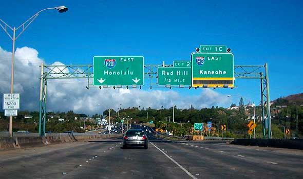 Overhead signs above Moanalua Freeway, eastbound at Interstate H-3 exit, including new Interstate H-201 sign