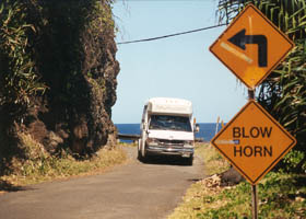 "Bus in middle of blind curve; ""Blow Horn"" sign"