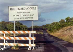 Lava closure of state route 130, with resident/landowner restricted access sign