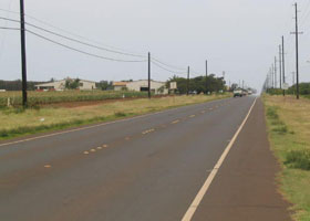 Staightaway on Kaumualii Highway (state route 50), near its west end