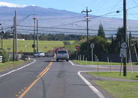 Wide view of south end of Kohala Mountain Road (state route 250), at junction with Kawaihae Road (state route 19) west of Waimea